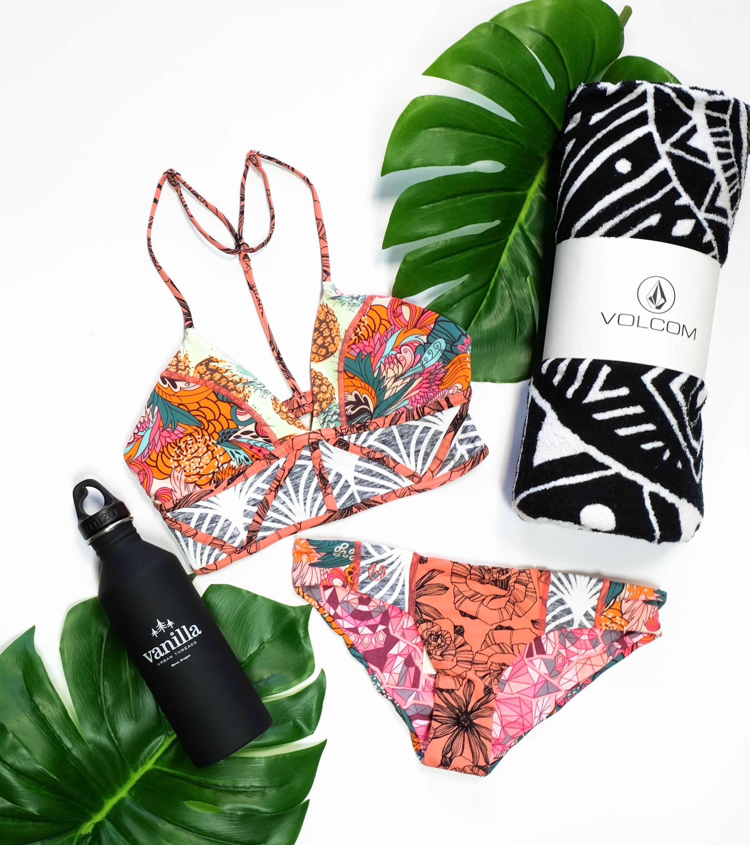 "Pictured : Maaji Swim Top Maji Swim Bottom Volcom Towel Vanilla (Mizu) Water Bottle  Okay it's day one and you're off on an adventure, what do you wear? I'm glad you asked. You can't go wrong with a cute little graphic tee and some shorts! This lightweight ""La Playa"" tee by Amuse is most fitting for your Mexico retreat (we have other sayings and colors in store too)! Now lets talk about these shorts, Blank just made a pair of basic shorts, your new favorite summer statement piece! All the cuteness isn't just in the front either, there's a little embroidery on the bum too. ;) My go-to shoes will forever be Vans so why not add a pop of coral with some high tops?!"