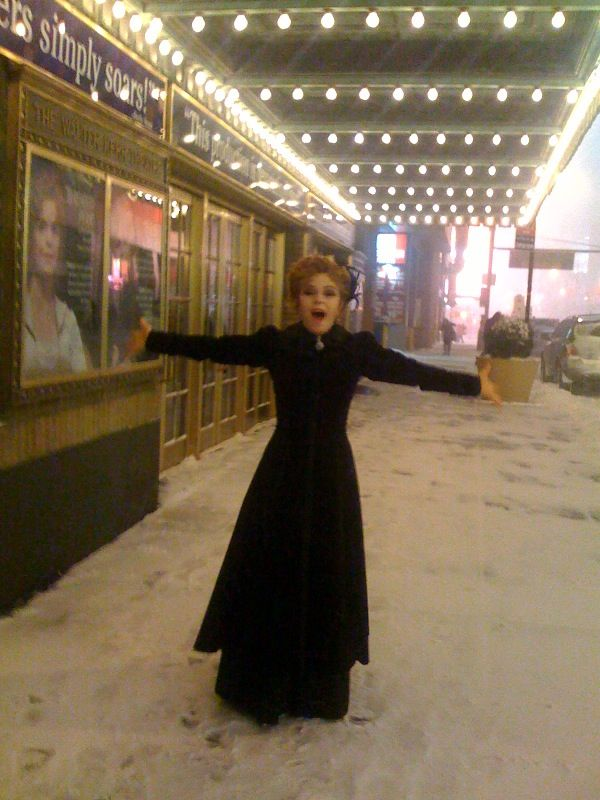 Desiree and Mr. Erlanson sneaking out to the snow in front of the Walter Kerr Theatre.