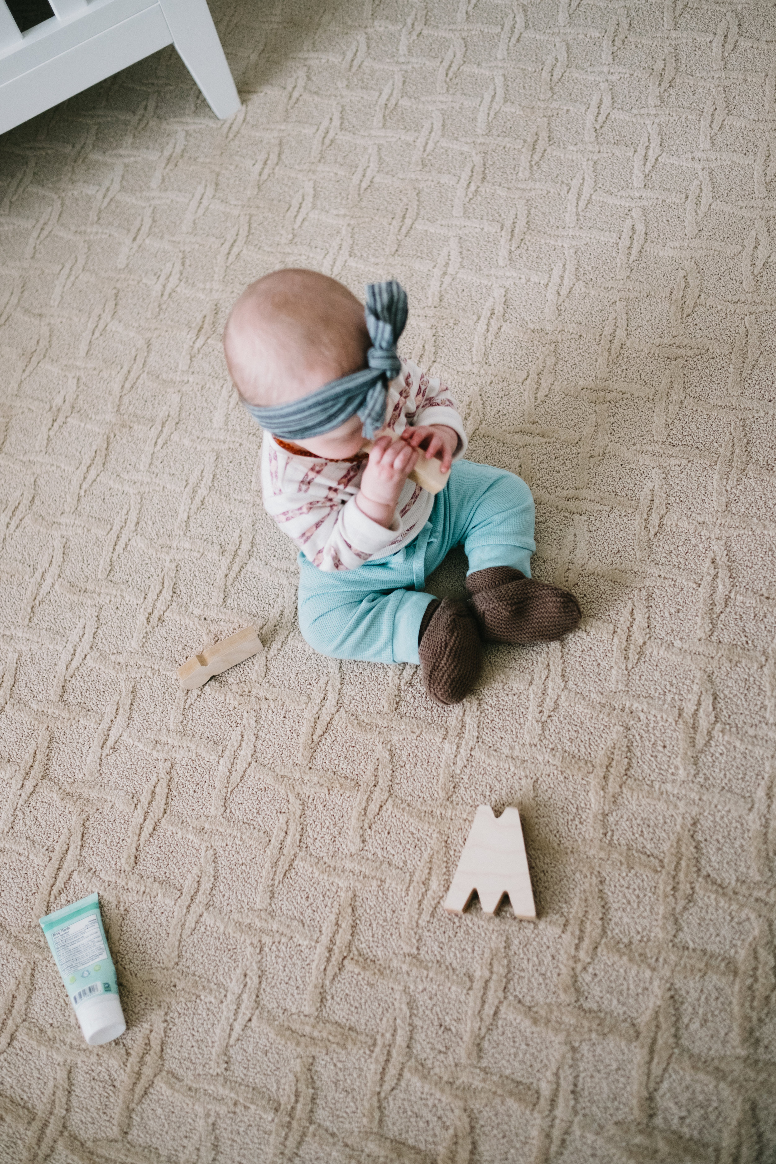 Baby on floor with blocks
