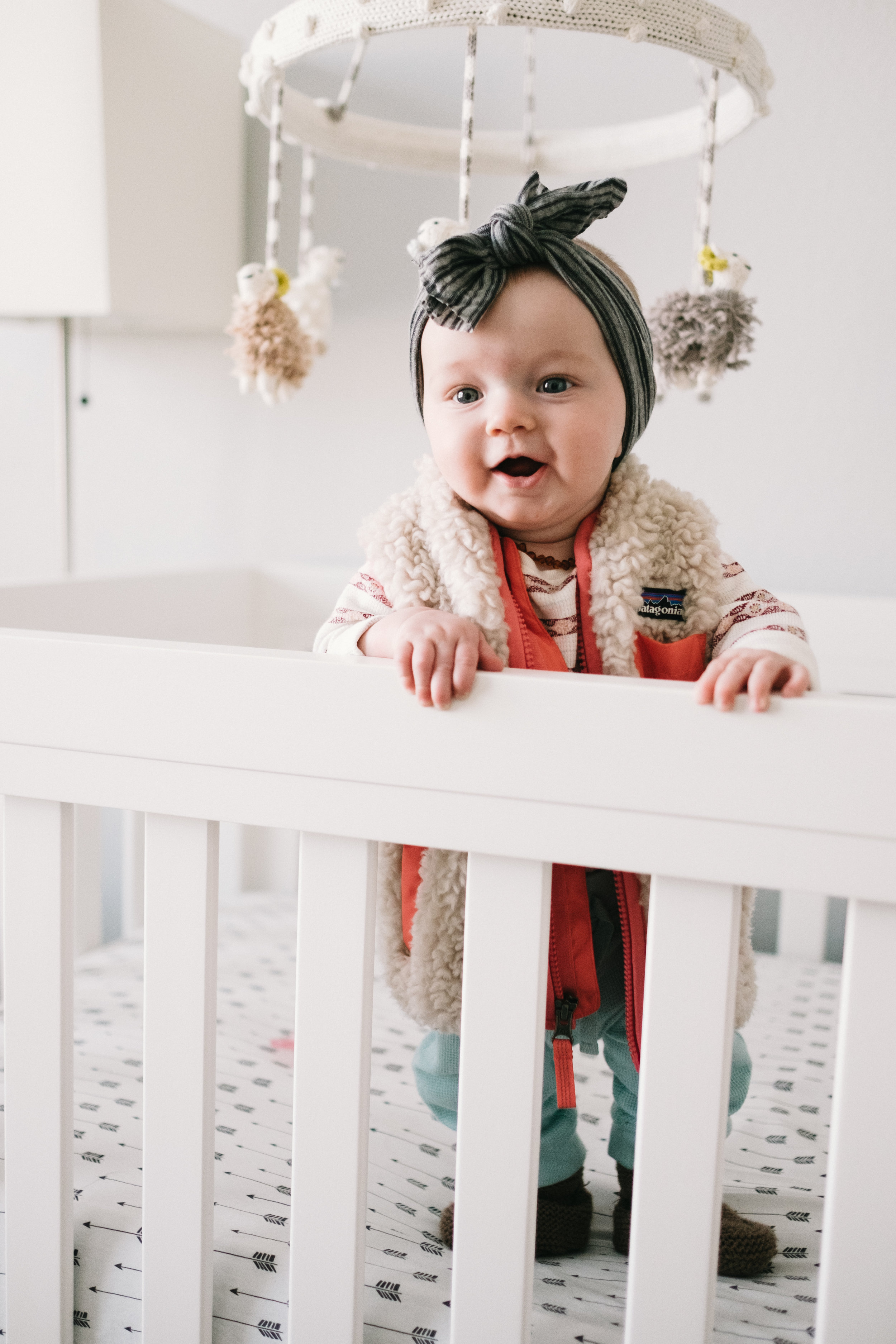 Baby girl standing in crib