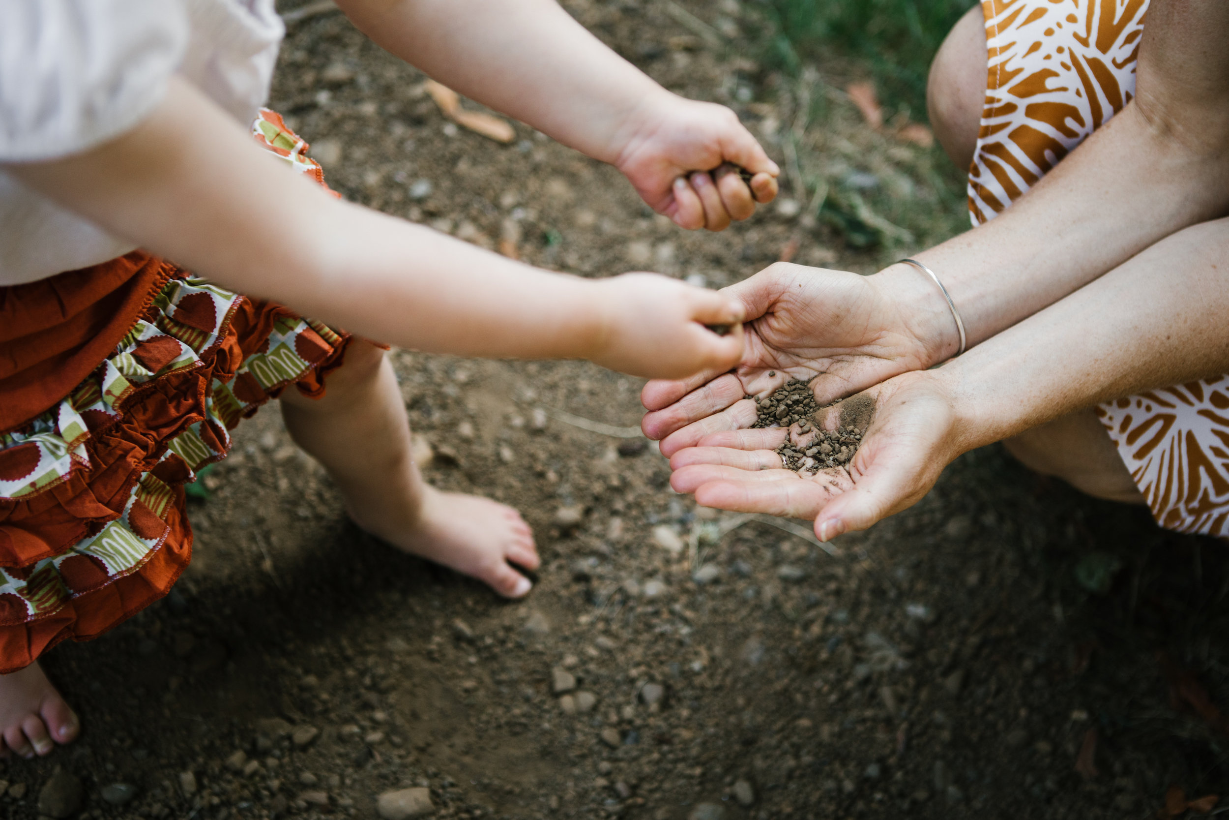 Toddler playing with dirt