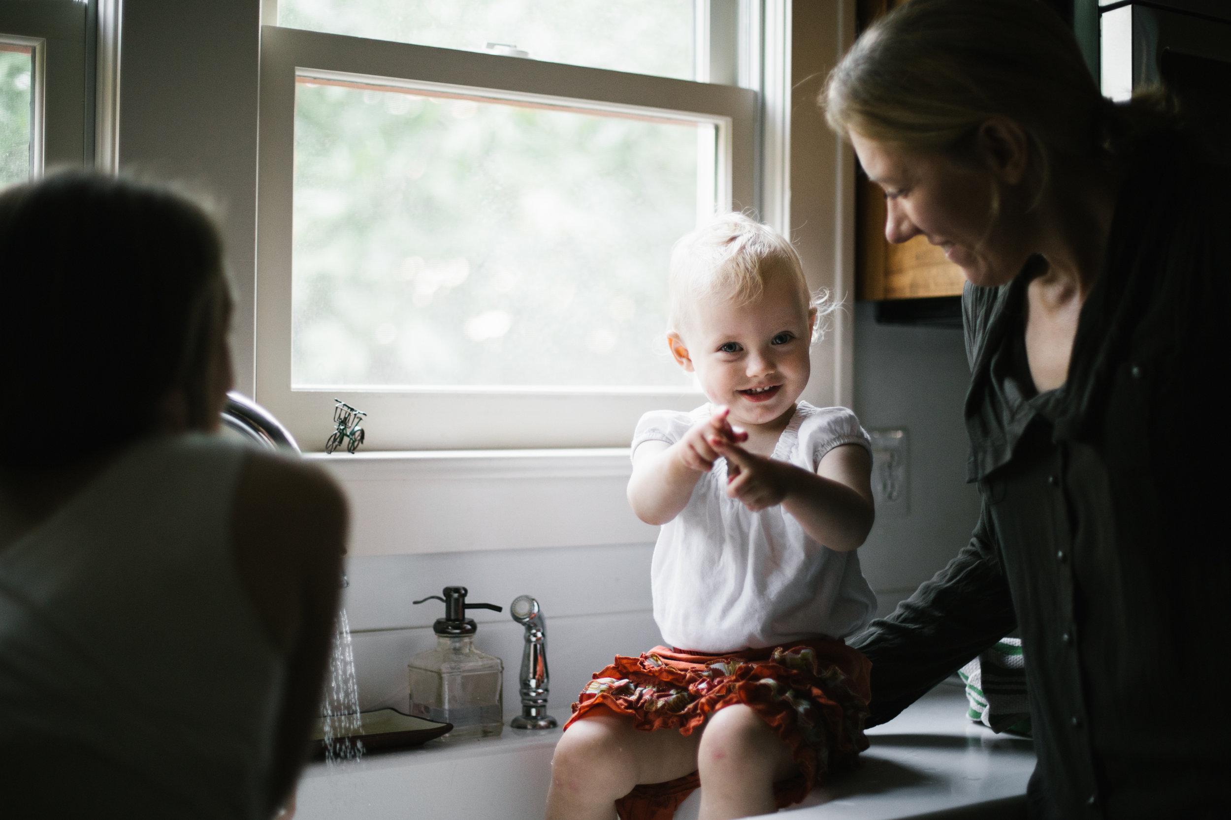 Toddler playing in sink