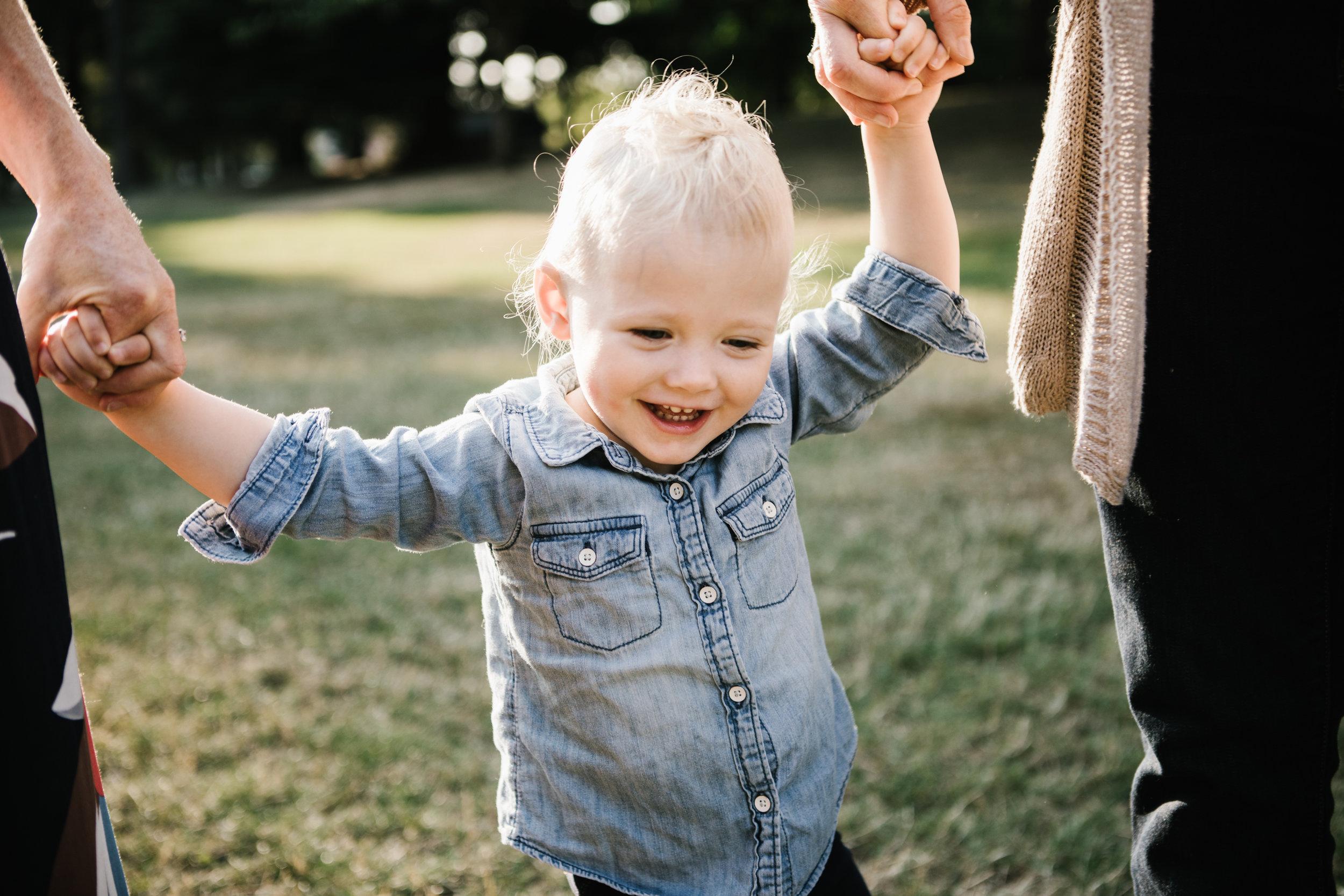 Smiling toddler girl outside