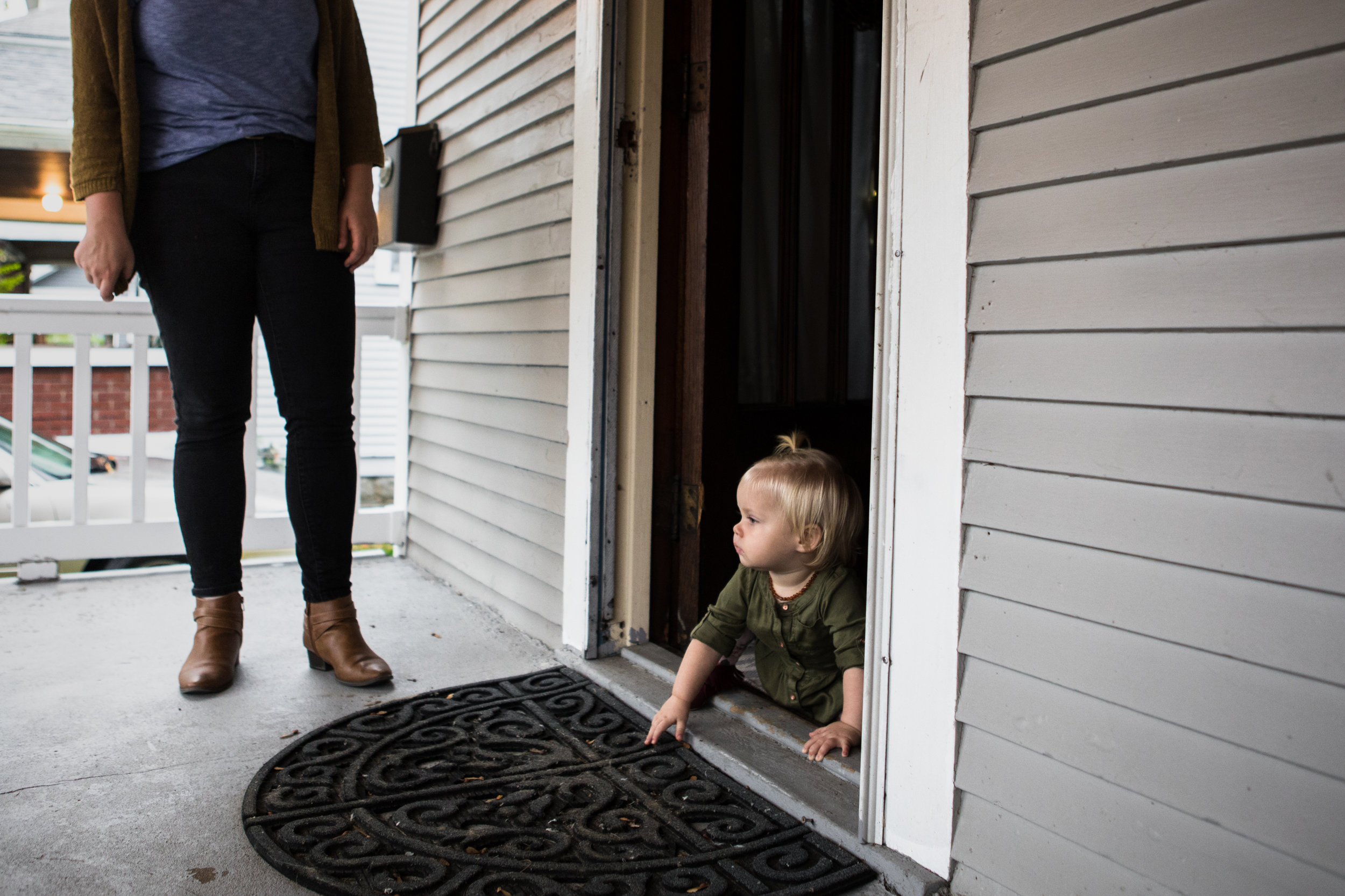 baby crawling out front door onto porch