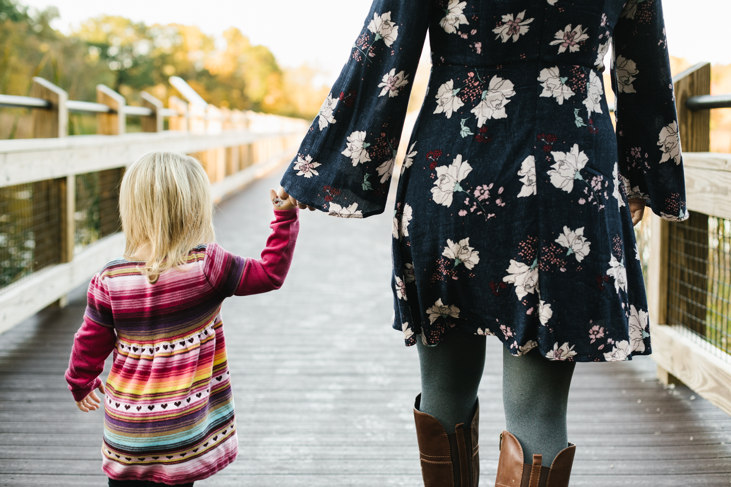 daughter holding mothers hand