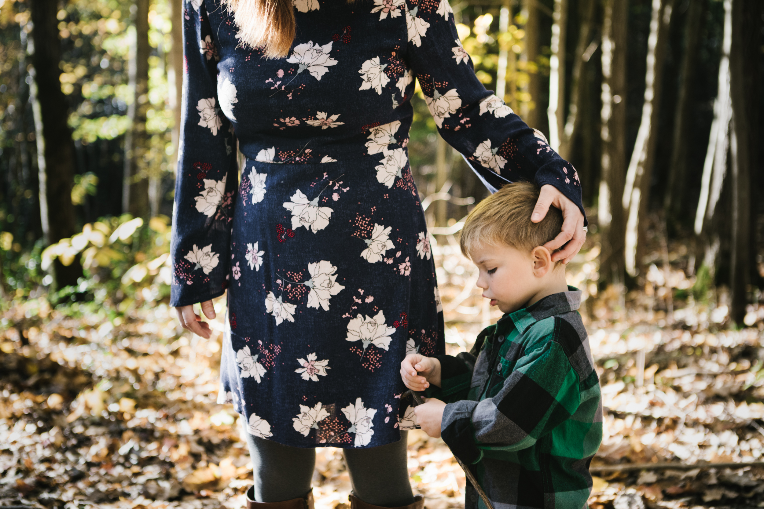 Mother with son in woods