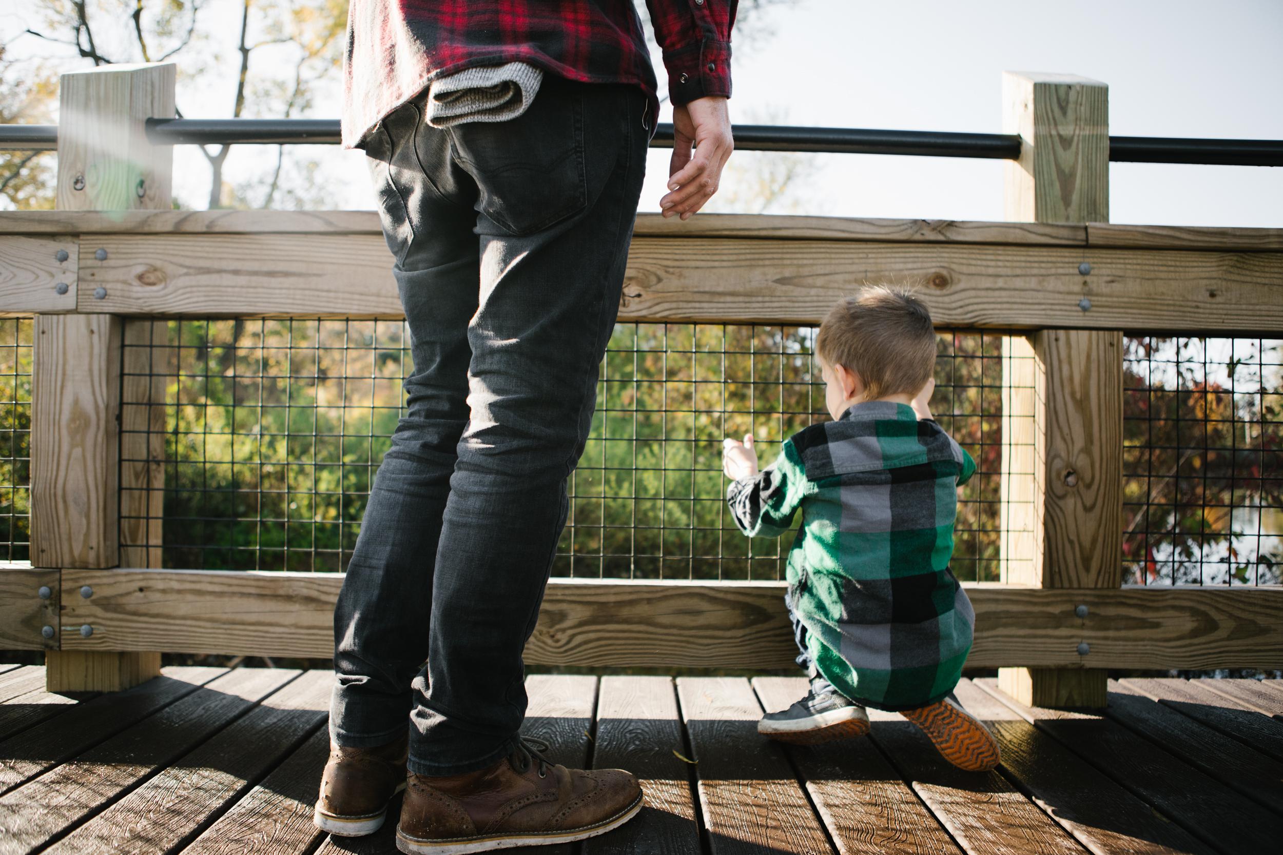 Son looking over bridge