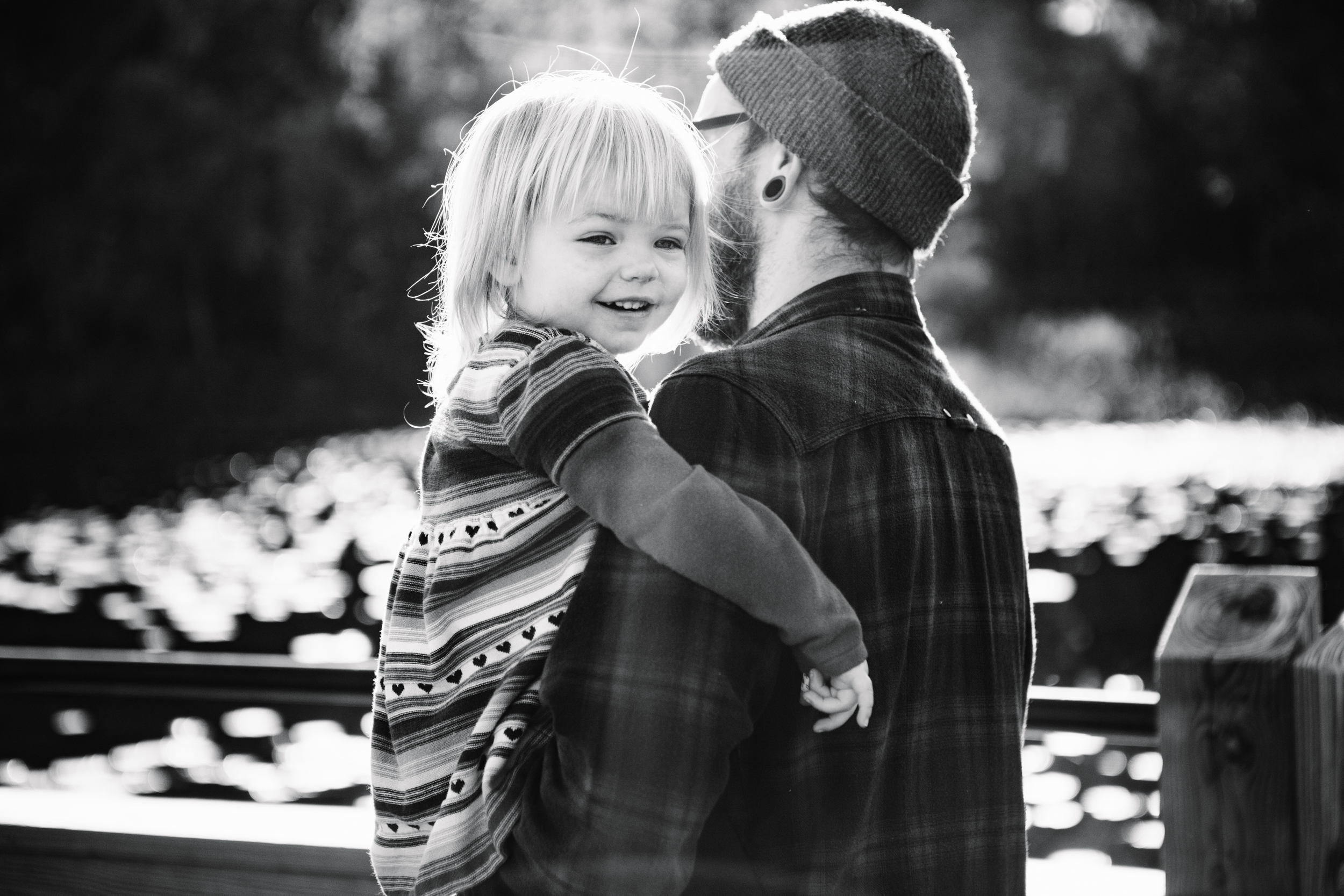 Smiling toddler in dads arms