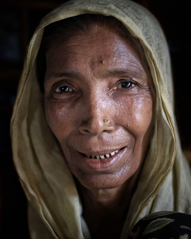 This woman is a refugee.  She was forcibly displaced from her home and is now living in the Nayapara refugee camp, just across the border from Myanmar.  Nayapara is one of the oldest refugee camps in Bangladesh and does not receive near the support and services proffered to other camps.  There is insufficient water supply as most of the wells have dried up.  Latrines are completely inadequate and health care is very limited . @food4thehungry and @medicalteams have a network of community health workers who are working in Nayapara to offer basic health promotion education, to identify cases of diphtheria amongst others and to support referrals to health care facilities . This woman is one of many who have received support and health education from our team of community health workers. She sat rapt with attention during her community health worker visit and gripped my hand so tightly as were were leaving that I thought I might not be able to exit the 'sauna' where she resides . . #withrefugees #refugeecamplife #refugee #rohingyarefugeecrisis #bangladesh #nayapara #potraits_ig #portraitsofficial #dslrofficial #humaninterestphotography #humanspirit #medicalteamsinternational #foodforthehungry #travelwithapurpose #support #rohingyacrisis #forciblydisplaced #genocide
