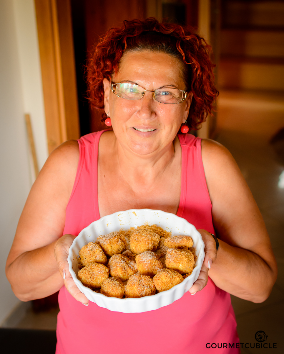 My mom, Rodica, holding a delicious bowl of túrógombóc