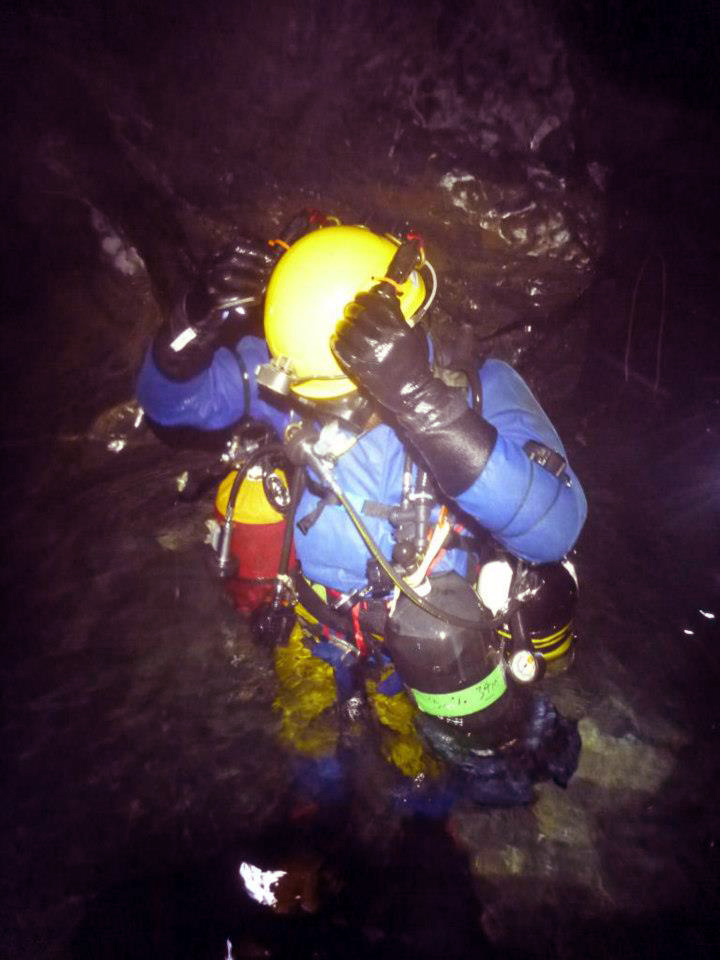 Jason Mallison prepares to descend into the uncharted terrain of Sump 9, nearly a mile deep.