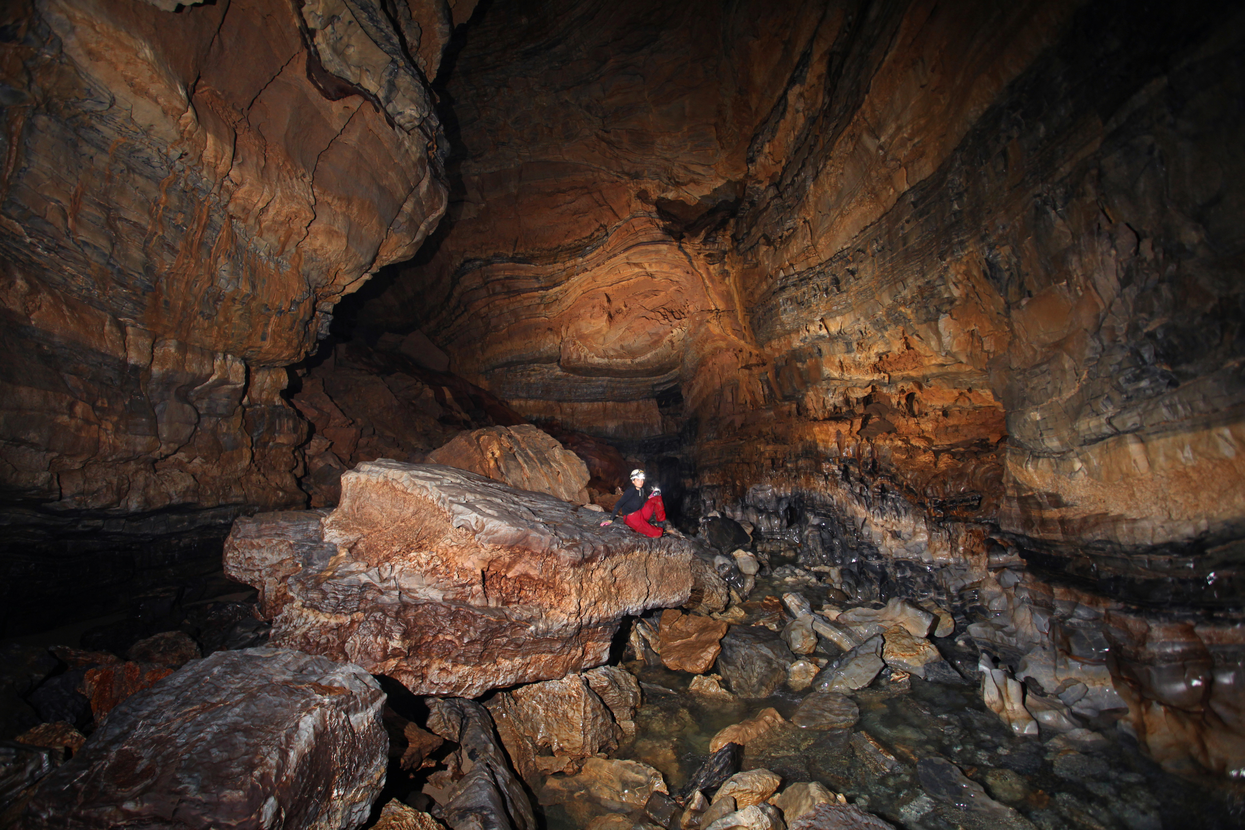 "Steph enjoys ""The Metro"" section of the Upper Gorge on our final day in the cave."