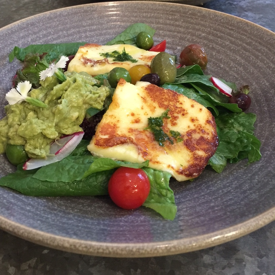 Vege Patch - garden greens, smashed avocado, oven roasted tomato and olives, grilled haloumi and parsley oil