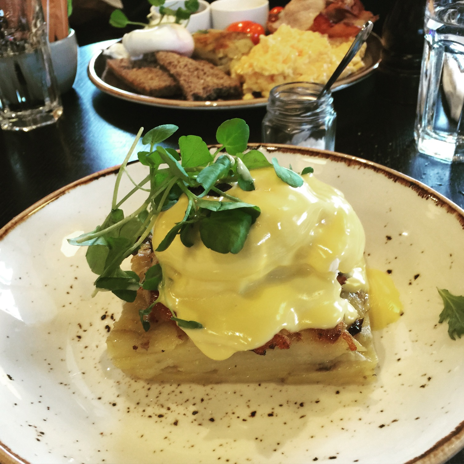 Poached egg, hot smoked salmon on potato galette with hollandaise