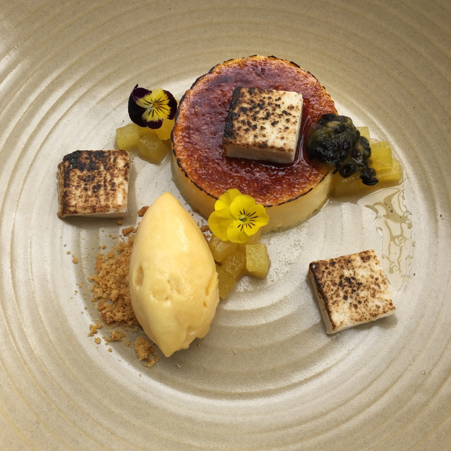 Coconut creme brulee with pineapple confit, banana marshmallow and passionfruit sorbet