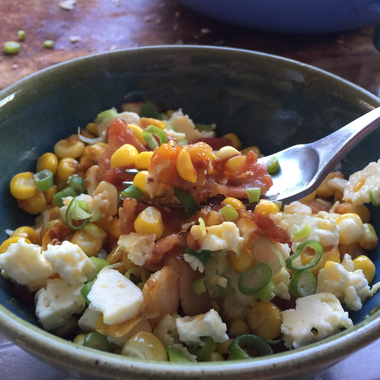 Sweetcorn, bacon and feta topped with buffalo sauce
