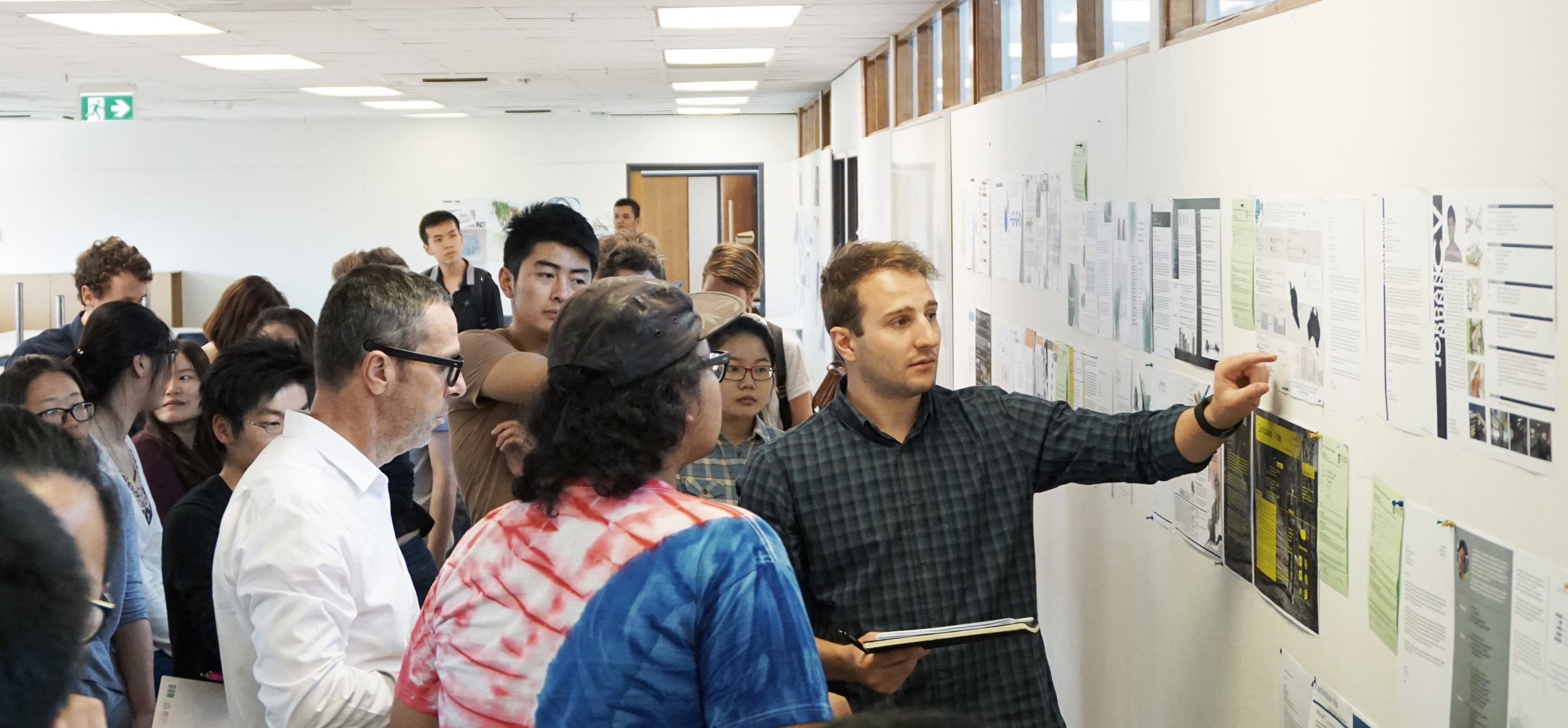 Tectvs Director Francesco Bonato (left) and Graduate of Architecture Adrian Rossi (right) perform acritique of student's work at the University of Adelaide