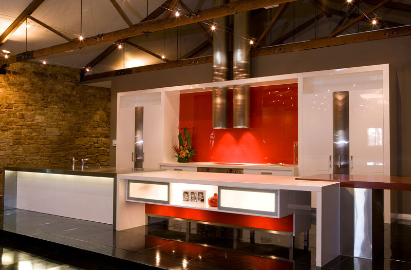 The former winery has been converted into a home, with a modern kitchen inserted into the existing building fabric