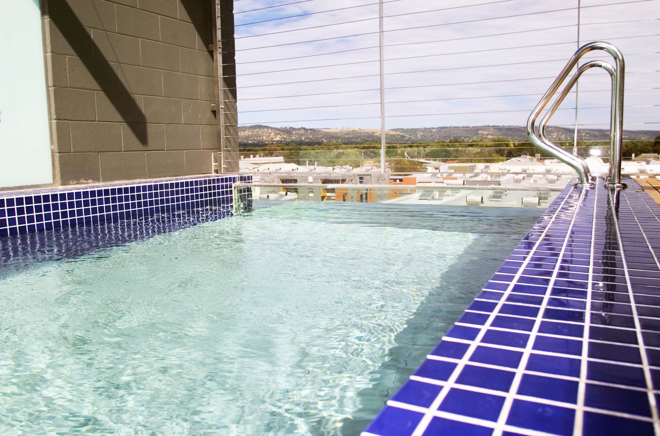 A rooftop pool serves as a communal space