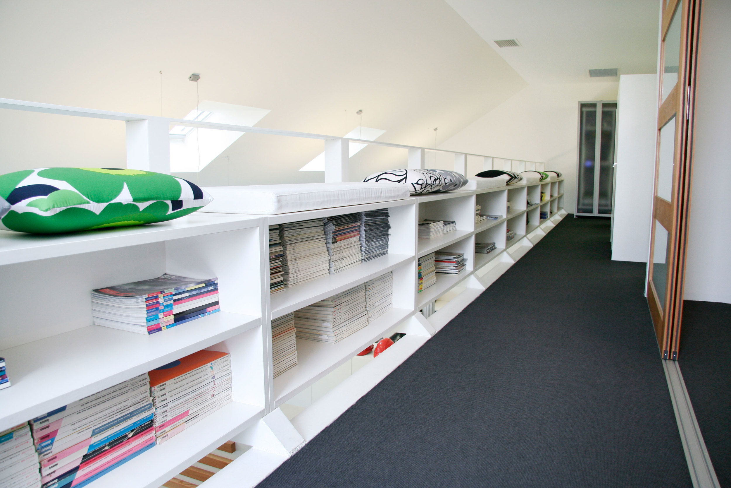 An upstairs galley serves as a library