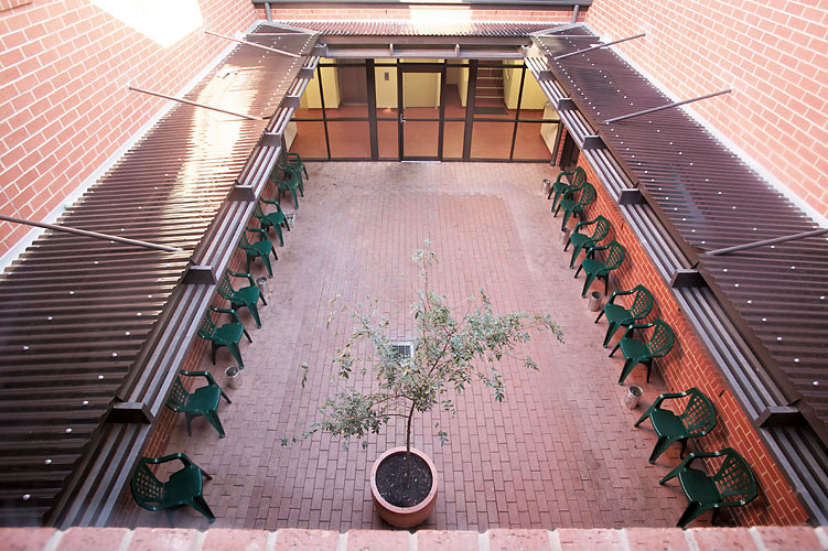An internal courtyard serves as the hostel's communal space