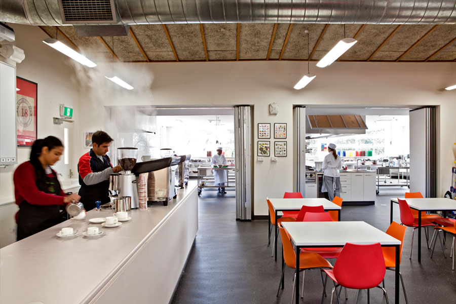 The kitchen is fully integrated into a service area