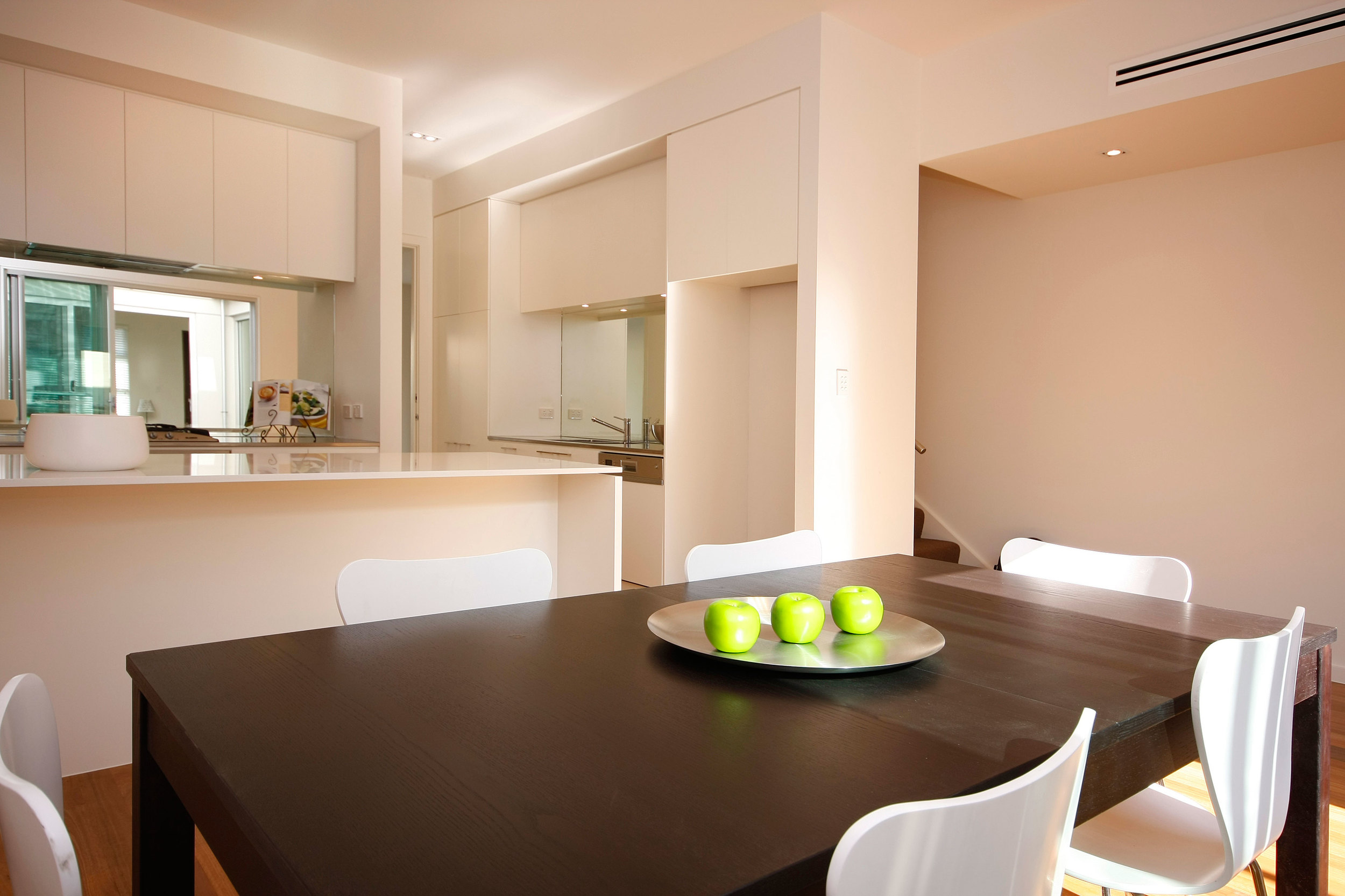 Open plan kitchen and living areas create flexible social spaces