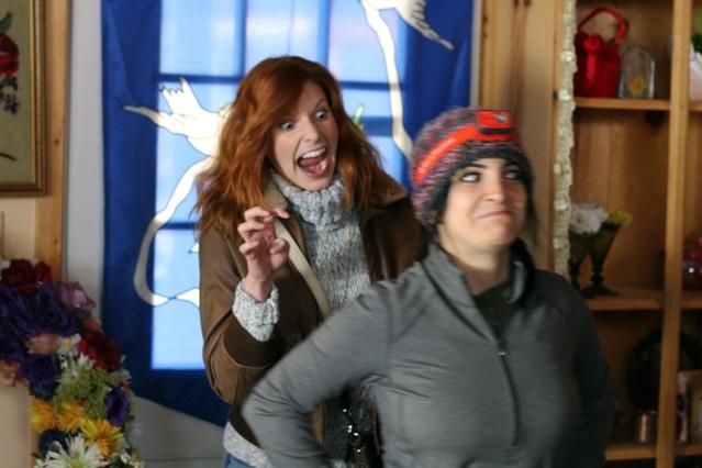 Tara having some fun with Best Boy Electric, Inga, on the Florist Shop set.