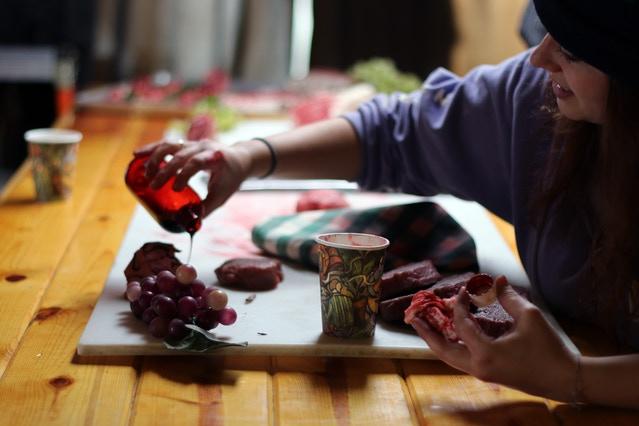 Art Director, Teagan, prepares props for the Butcher Shop.