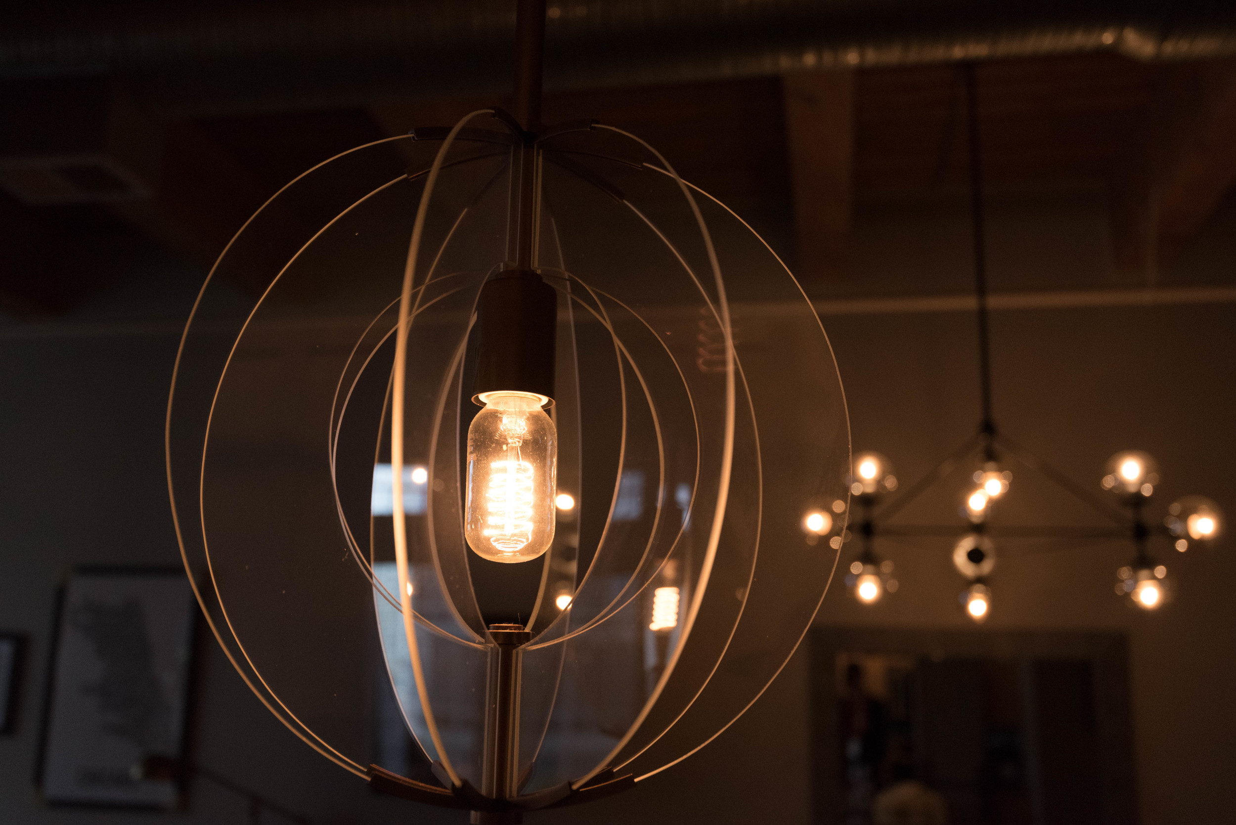 Updating their existing island pendant lights with these gorgeous brass and glass fixtures with edison bulbs add so much more interest and elegance to the space.