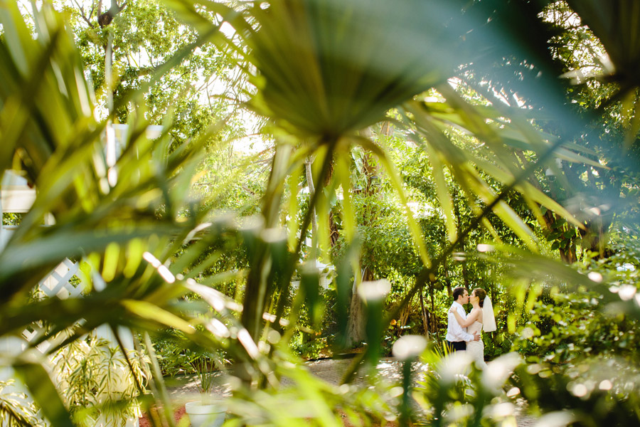 romantic creative portraits of bride and groom at the hemingway home in keywest, florida, destination photographer