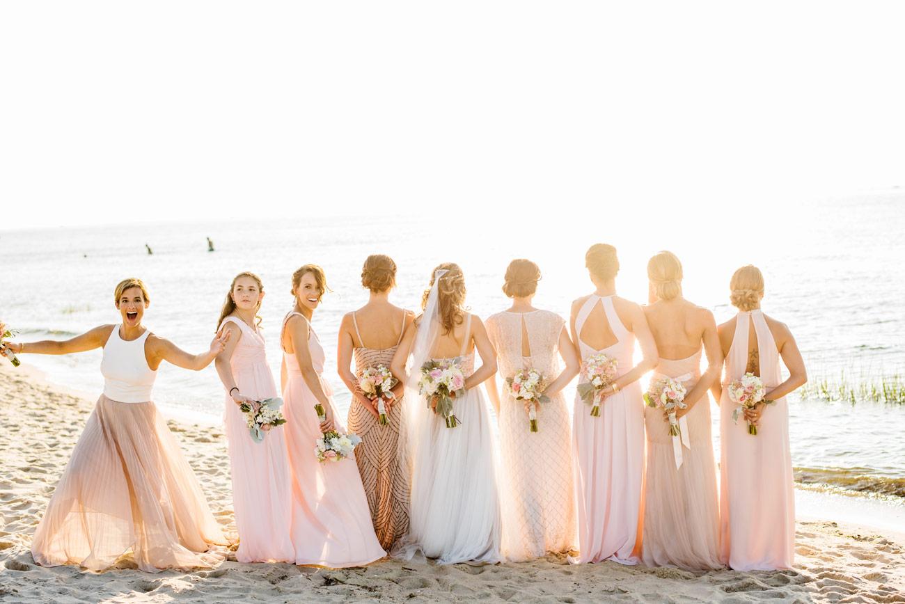 stunning bridesmaids on the beach at the ocean edge resort , cape cod wedding photographers