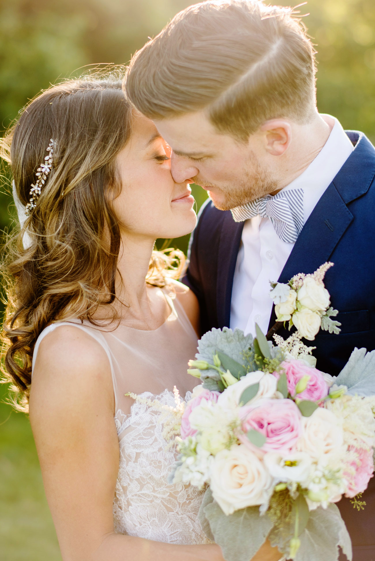 bride and groom kissing in brewster , ma at the ocean edge resort venue