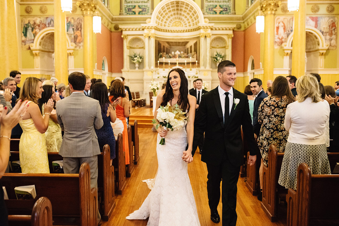 bride and groom married at st. cecilia church in bosotn, ma