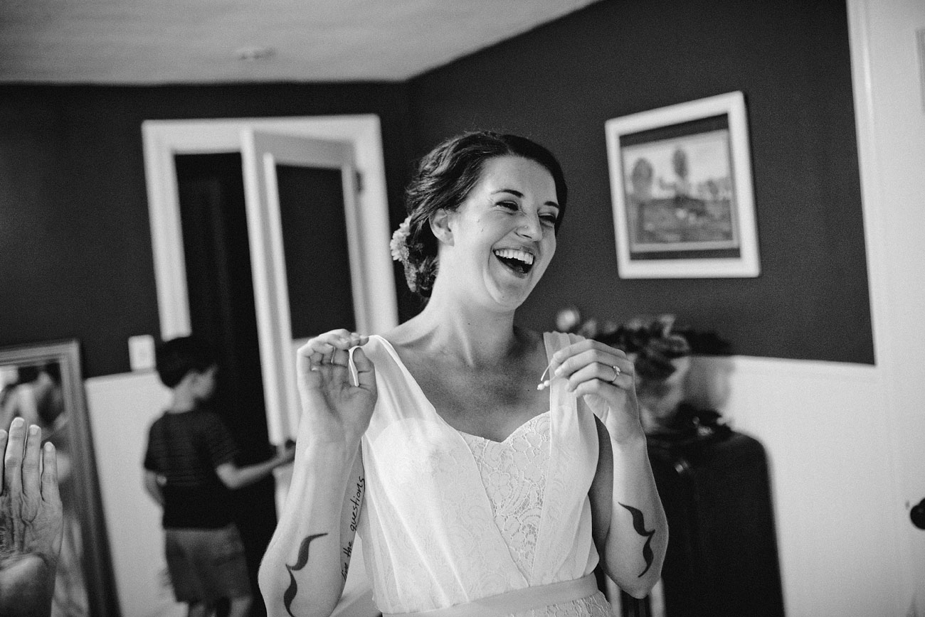 fun bride getting ready moment in a backyard wedding massachusetts