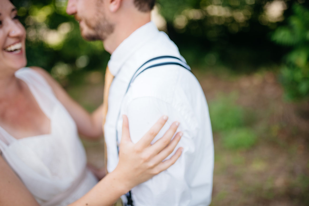 real moments with the bride and groom at a backyard wedding in new england