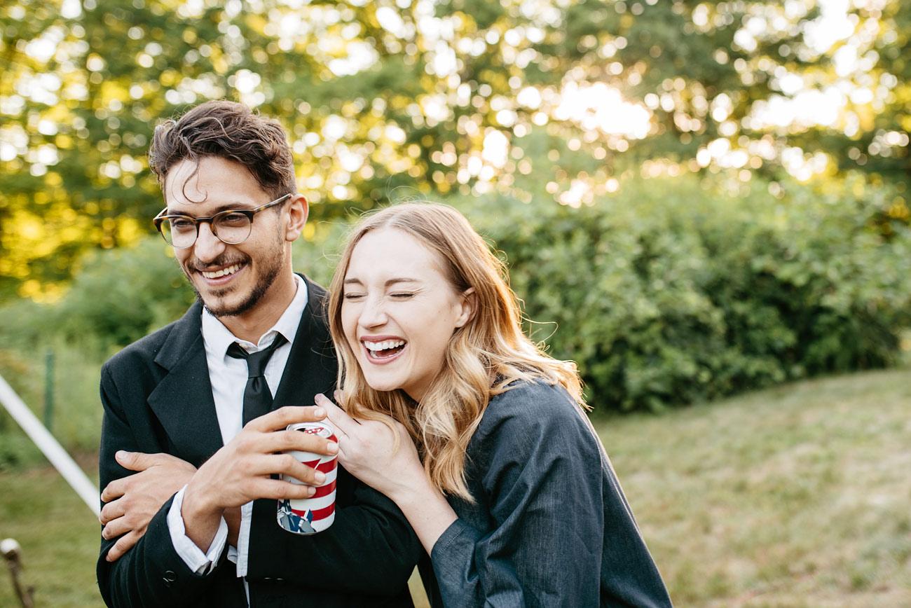 fun couple at a wedding laughing  fun backyard wedding moments in new england
