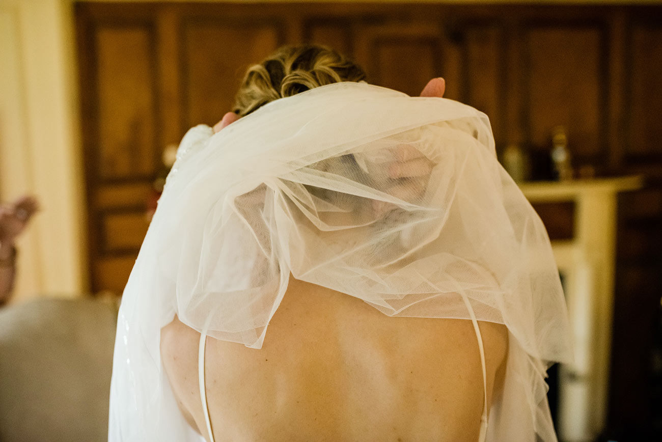 bride getting ready for her small wedding at the newcomb tavern in sandwich ma, cape cod wedding