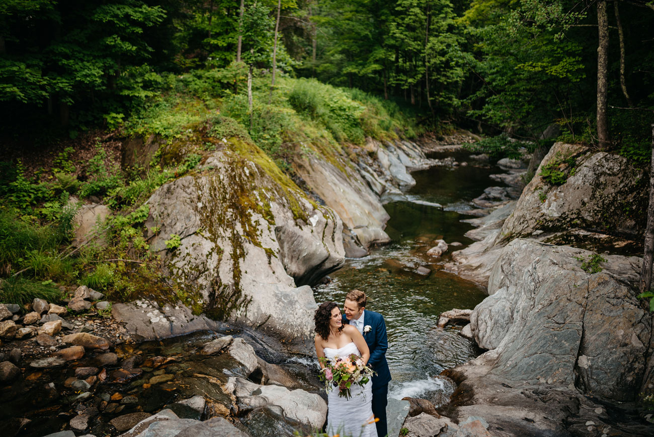 creative landscape portrait of a lovely bride and groom at the pitcher inn in warren vermont, vermont wedding venues