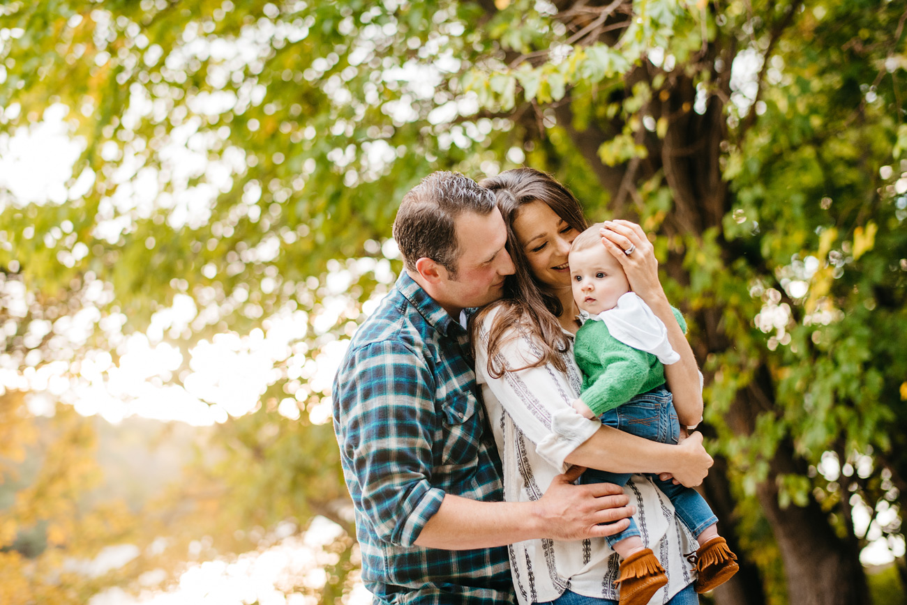 cute family under a tree during their lifestyle family session