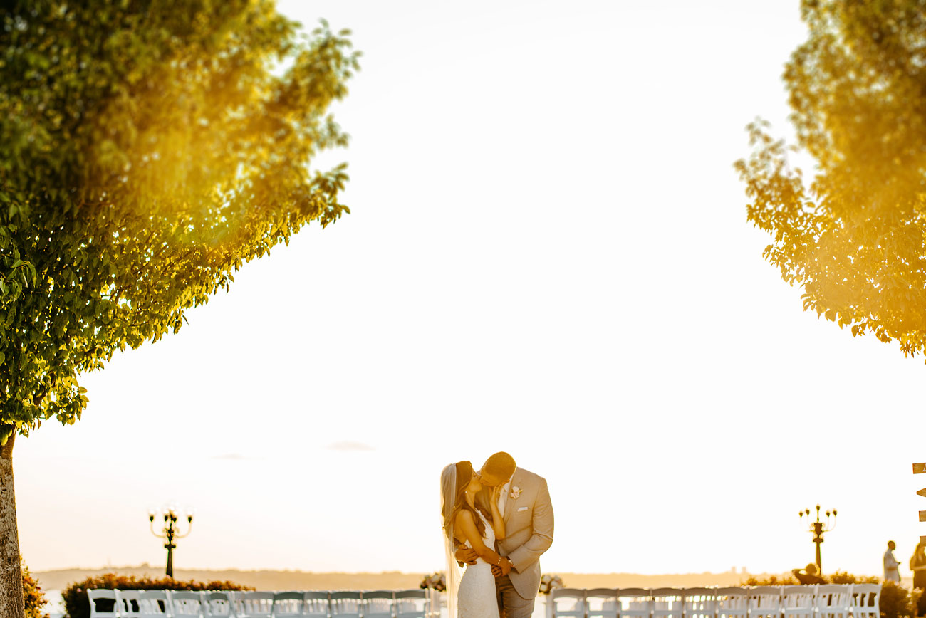 newport ri private estate outdoor weddings sunset weddings bride and groom kissing