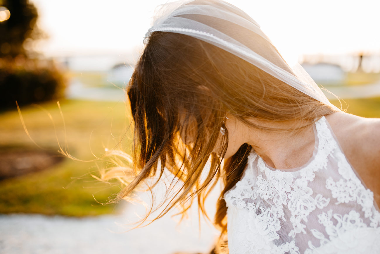 bridal portrait, stunning portraits brides hair blowing in the wind newport ri bohemian weddings