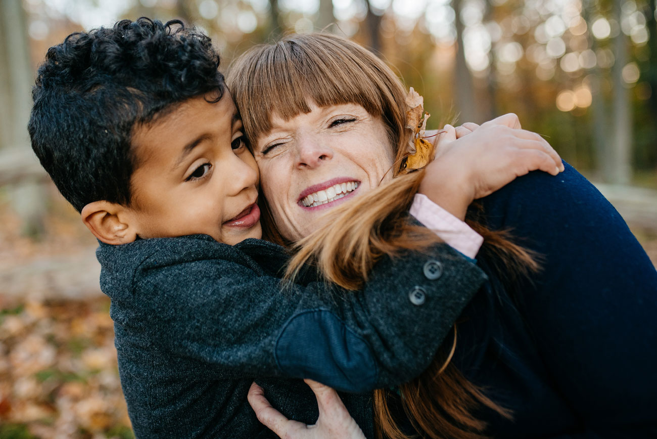 cute kid hugging mom during lifestyle family photo session fun and creative photos