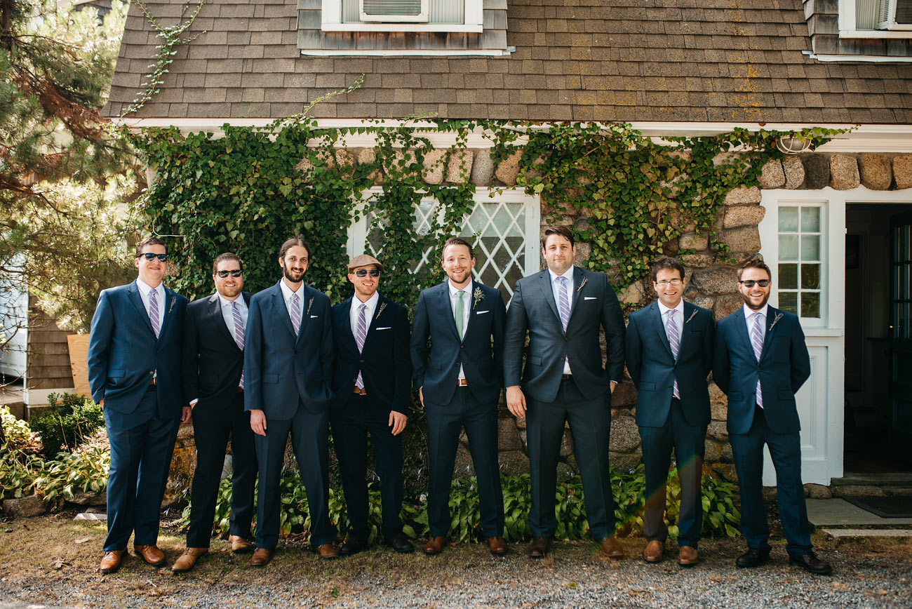 groomsmen hanging out casually at the eastern point yacht club gloucestor, ma wedding photographers