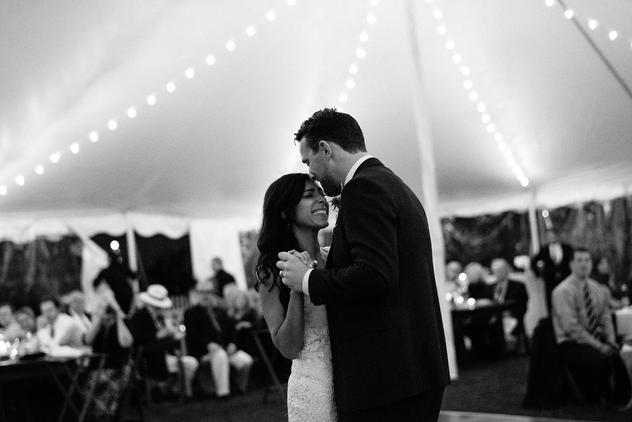 bride and groom first dance at the eastern point yacht club in Gloucestor, MA in a tent