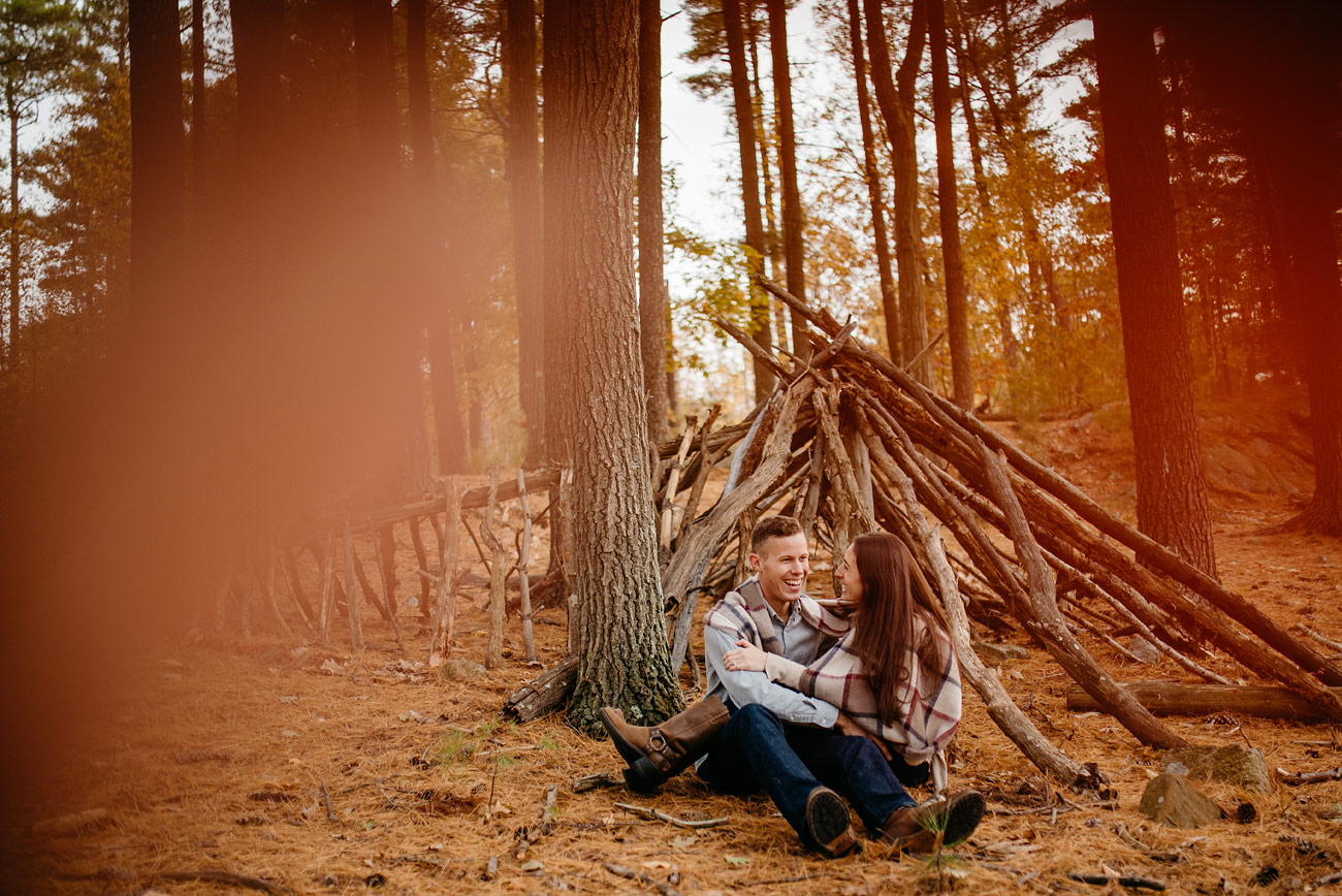 new england adventure cute couple during their engagement session wanderlust