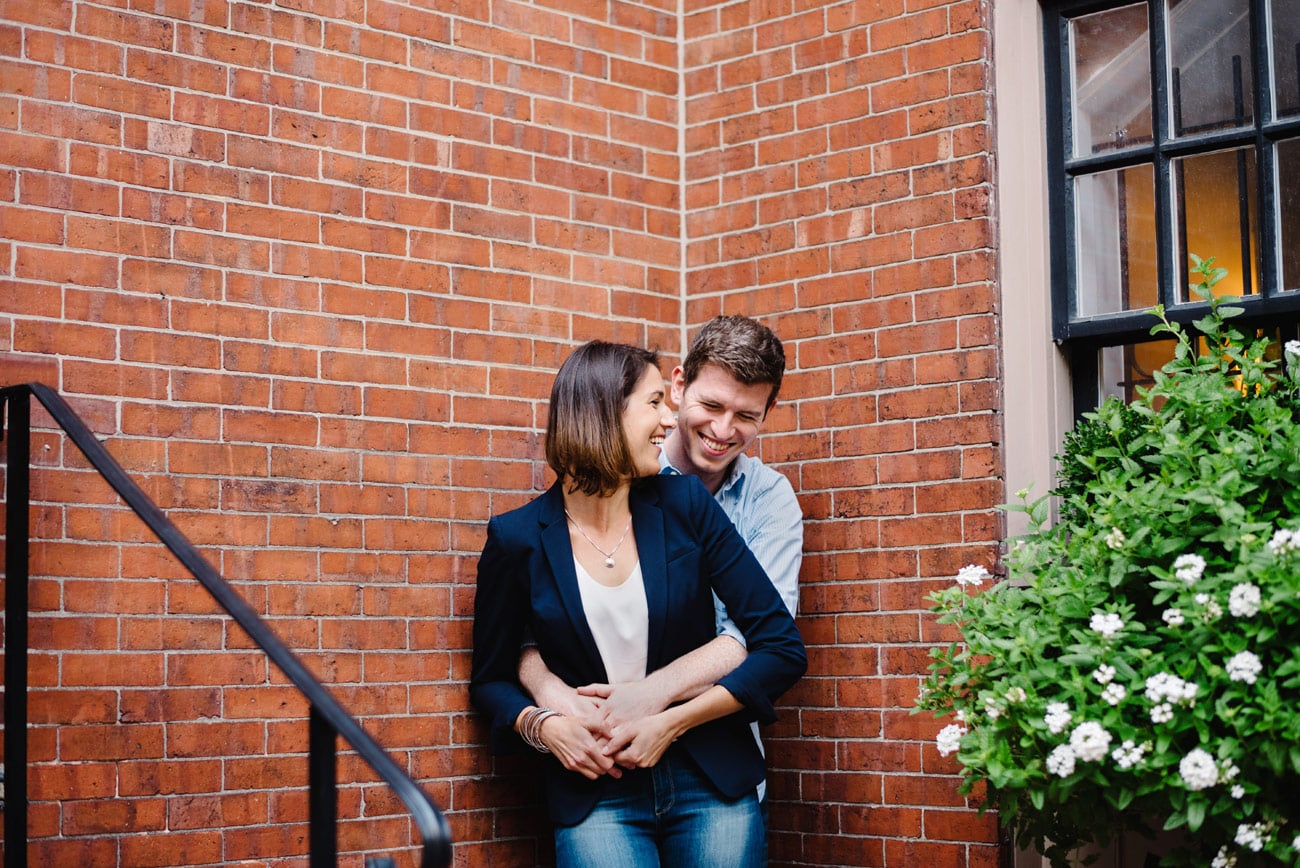 fun and lifestyle boston engagement photos in beacon hill by a brick wall