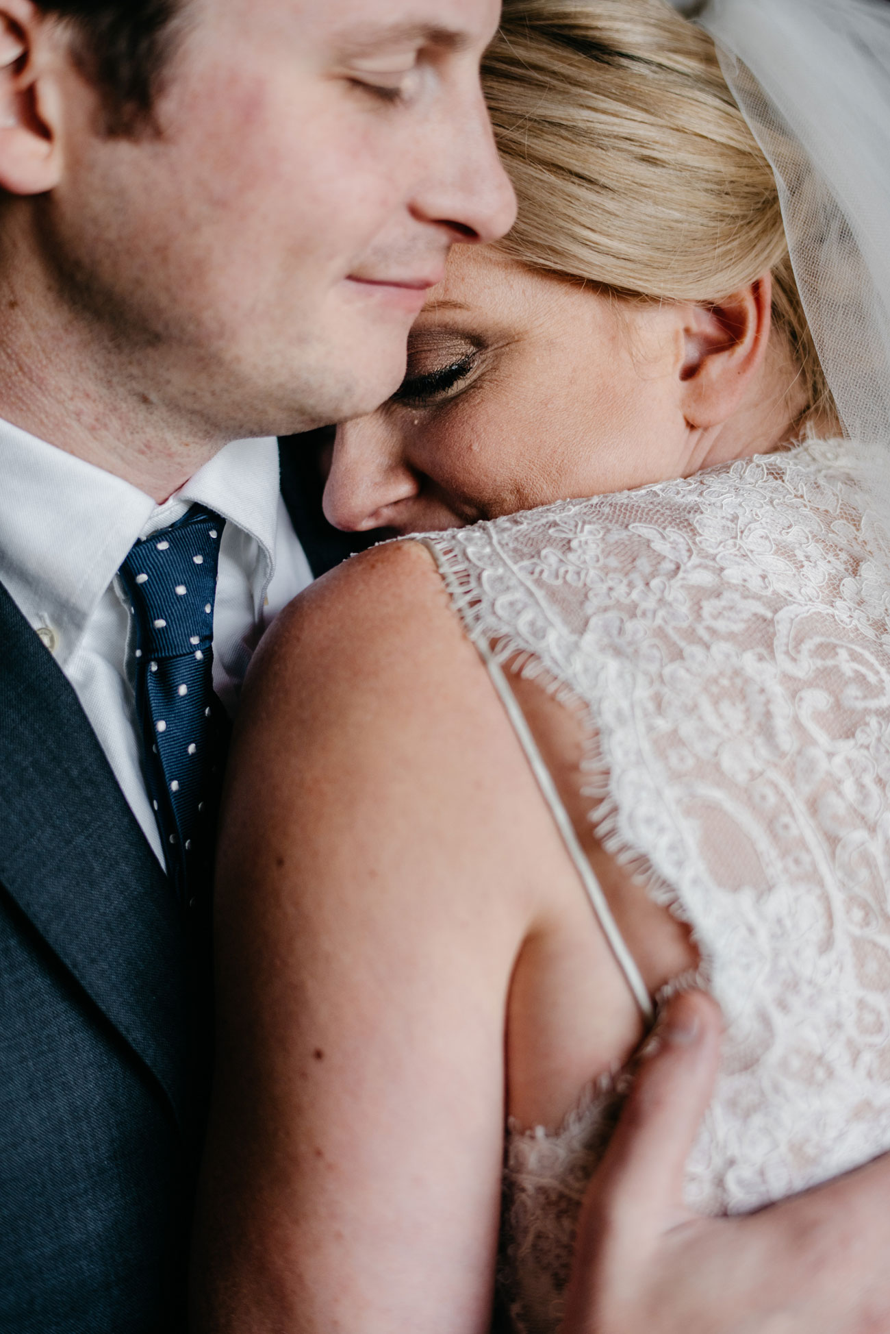 cute moment with bride and groom at a private estate in new england