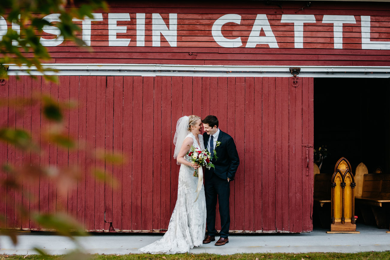 bride and groom laughing together in new hampshire  at bishop farms, rustic new england wedding photography
