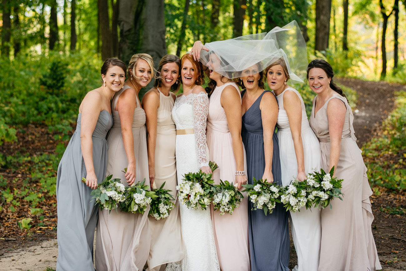bride with veil in the wind in michigan at aquinas college married